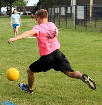 BSSC Sports Adult Coed Kickball Player in pink kicks ball while player waits on first